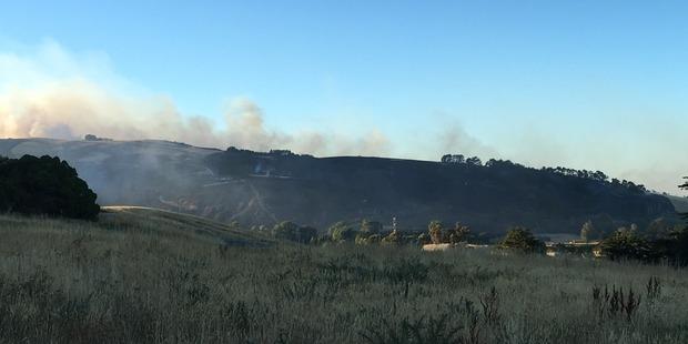 Morning light reveals the blackened hillside after last night's fire. Photo / Joshua Price