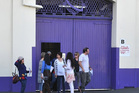 Cadbury staff leave the Dunedin factory after being briefed on the proposal to end operations. Photo / Otago Daily Times