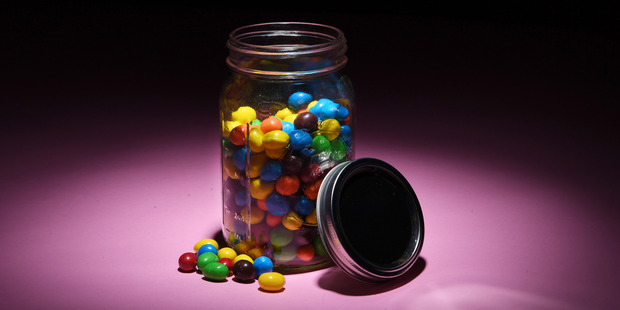 Relatively few are brazen enough to grab peanut M&Ms from Washington Post Executive Editor Marty Baron's jar. Photo / Washington Post