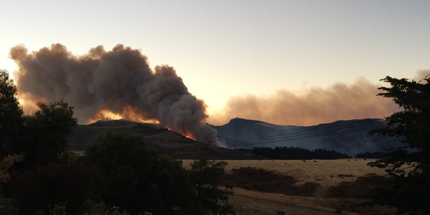 Plumes of smoke billow from fires in Christchurch's Port Hills this morning. Photo / Joshua Price