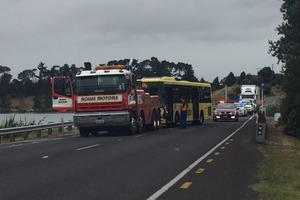 A bus involved in a crash on Maungatapu Bridge is about to be towed. Photo/George Novak