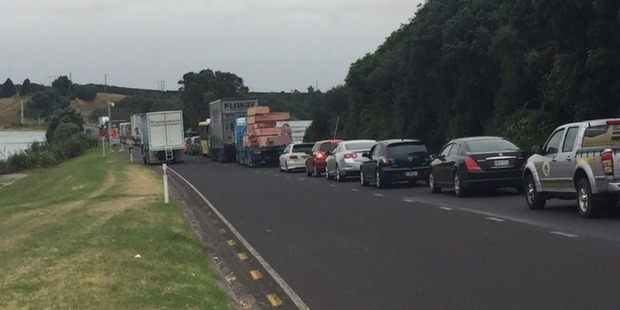 Traffic has been brought to a standstill at Maungatapu Bridge after a bus crash this morning. Photo/George Novak