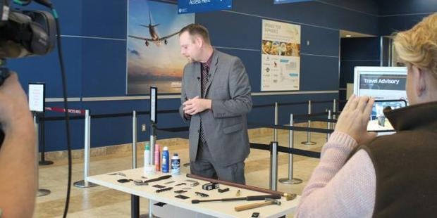 TSA spokesman Mark Howell with the sword and other confiscated items. Photo / Facebook