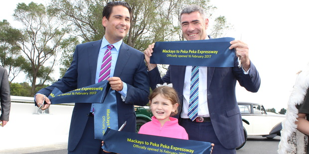 Transport Minister Simon Bridges, Otaki MP Nathan Guy, and Waikanae girl Grace Ahern, 6, after cutting a ribbon to mark the completion of the Mackays to Peka Peka Expressway. Photo / David Haxton