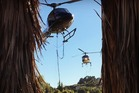 Helicopters assisting in the firefighting efforts collect water from the Halswell quarry. Photo / Kieran Harrington
