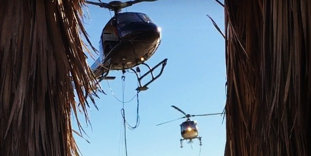 Loading Helicopters assisting in the firefighting efforts collect water from the Halswell quarry. Photo / Kieran Harrington