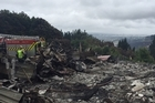Distraught residents of fire-ravaged Worsleys Rd are allowed back to visit their destroyed homes. Tristram Clayton was there with them when they discovered the extent of the damage.