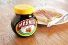 Unilever makes Marmite and has 13 brands which generate over €1bn in revenues including Dove, Hellmanns and Surf. Photo / Getty Images