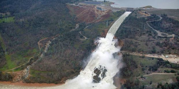 This aerial view looks east toward Oroville Dam and Lake Oroville, showing the damaged spillway on February 15. Photo / California Department of Water Resources