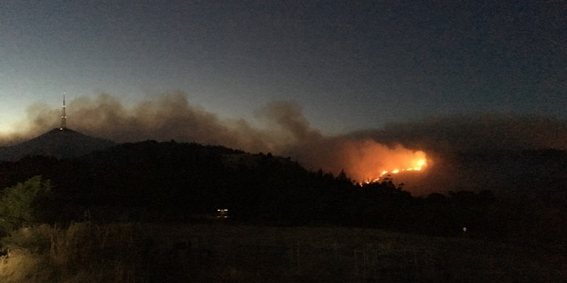The fire worsened overnight and large flames are visible from several kilometres away. Photo / Joshua Price