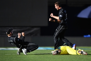 New Zealand bowler Tim Southee (centre) loves being involved in tight finishes such as this one at Eden Park.  Photo / Photosport