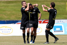 Tom Jackson (C) of Team Wellington celebrates a goal. Photo / Photosport