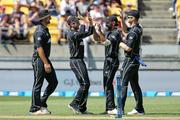The Black Caps celebrate a wicket. Photo / Photosport