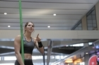Olympic silver medallist Eliza McCartney jumps pole vault at Britomart train station