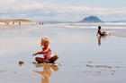 Amber Dickinson, 2, loves play in the sand at Papamoa Beach. Photo/Ruth Keber