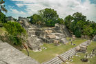 Tourists explore the Mayan ruins at Tikal. Photo / 123RF