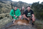 Olympic shot put champion Ryan Crouser (left), Kiwi Tom Walsh (right) and guide Toby Morris with a red deer bagged in Marlborough. Photo / Mark Mitchell