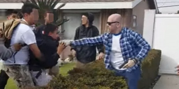 Loading Cellphone video shows the shocking moment an off-duty police officer almost shot a teenager who he was scuffling with outside his home. Photo / YouTube
