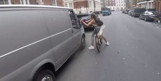 The cyclist quickly ripped the wing mirror off the van and continued on her way.