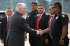Rex Tillerson is greeted by police officers and security personnel at Mexico City's international airport. Photo / AP