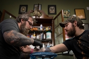 Dave Cutlip works on Randy Stiles during one of the two two-hour sessions it took to cover his original tattoo.