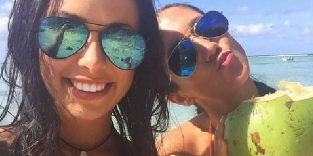 Melina Roberge (left) and former porn star Isabelle Lagace posted during their luxury world cruise which ended in their arrest. Photo / Facebook