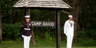 In this June 26, 2008, file photo, members of an honor guard stand at attention at Camp David. Photo / AP