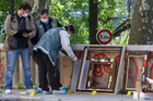 This May 20, 2010 file photo shows police officers searching for clues as they pack up the frames of the stolen paintings outside the Paris Museum of Modern Art, in Paris. Photo / AP