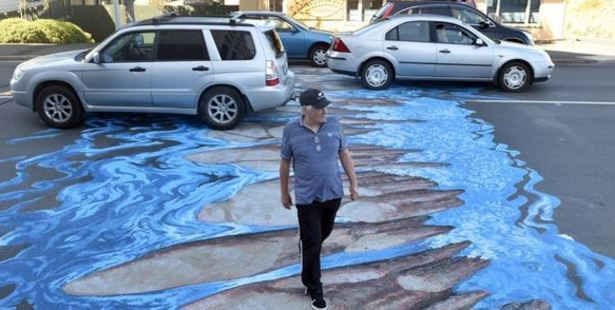 The paintings create an optical illusion, appearing 3-D to motorists while being flat to pedestrians. Photo / Otago Daily Times