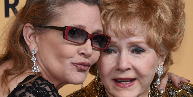 Actresses Debbie Reynolds (R) and her daughter Carrie Fisher. Photo / Getty