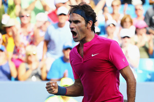 Roger Federer celebrates after defeating Andy Murray. Photo / Getty Images