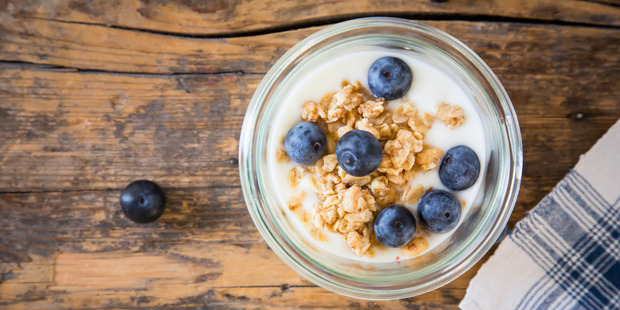 Yoghurt is good for improving bone health and keeping you fuller for longer. Photo / Getty