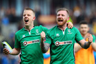 Lincoln City players Terry Hawkridge (L) and Alan Power celebrate after Lincoln's 1-0 win over Premier League side Burnley at the Turf Moor in Burnley this morning (NZT). Photo / Getty Images.