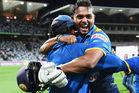 Asela Gunaratne of Sri Lanka is congratulated by teammates after hitting the winning runs to win the second International Twenty20 match. Photo / Getty