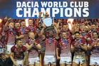 Wigan Warriors captain Sean O'Loughlin lifts the World Club Challenge trophy following Wigan's 22-6 win over the Cronulla Sharks at DW Stadium in Wigan. Photo / Getty Images.