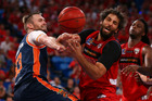 Mark Worthington of the Taipans and Matt Knight of the Wildcats contest for a loose ball. Photo / Getty Images