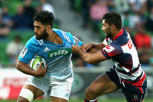 Akira Ioane of the Blues attempts a fend. Photo / Getty