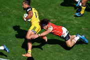 Derek Carpenter of the Sunwolves attempts to tackle Matt Proctor during the Hurricanes' big win. Photo / Getty