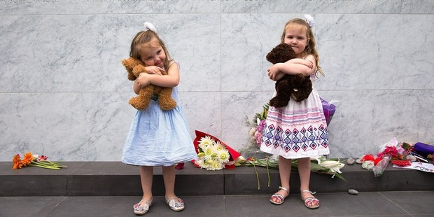 Loading Every year, on the anniversary of his death, the three and four-year-old's place their teddies and flowers as his grave. Photo / Martin Hunter, Christchurch Star
