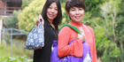 Chika Crooks and Noriko Collins with bags made from kimonos. Picture / Doug Sherring
