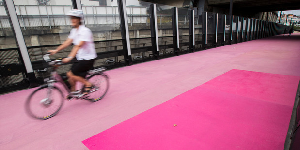 Auckland's $18m pink cycleway will be getting a new layer of sun protection that will give its faded appearance a more durable colour boost. New Zealand Herald Photograph by Jason Oxenham.