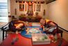 Tibetan Buddhist monks L-R Ven. Karma Gyasey and Ven. Geshe Jamyang Sherab, creating the Medicine Buddha Mandala for global healing and world peace. Photo/John Borren