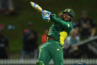 South Africa's Andile Phehlukwayo hits a six in the final over of Sunday's ODI against New Zealand at Seddon Park. Photo / Photosport.