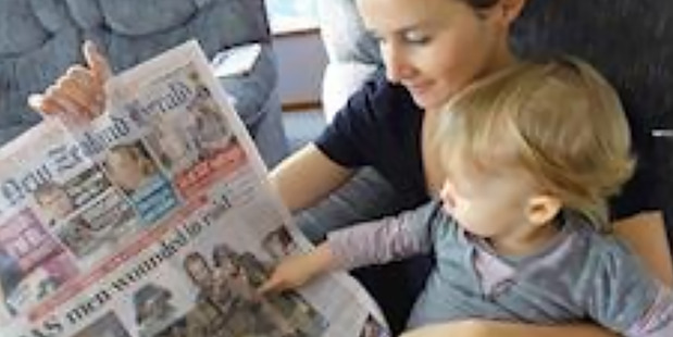 Elizabeth Askin shows her daughter Herald front page story on her hero daddy. Picture / Askin Family