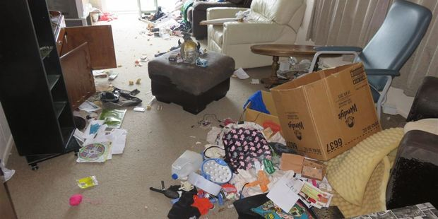 Tenant possessions and rubbish left in the lounge of Goodwin's house last year, after the property was vacated.