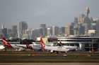 Qantas Airways reported a slide in first-half profit but its Jetstar Group did better.