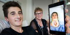 Morgan Honnor and his mother Deborah Weir-Honnor, with a photo of Morgan in a neckbrace during his first visit to the hospital recently. Photo / Alan Gibson