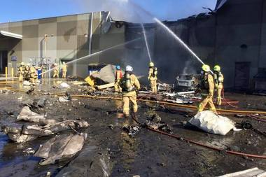 Firefighters work to douse flames at the DFO shopping complex at Essendon. Photo / Facebook