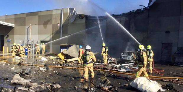 Firefighters work to douse flames after the aircraft crashed into a section of the DFO shopping complex at Essendon. Photo / Melbourne Metropolitan Fire Brigade