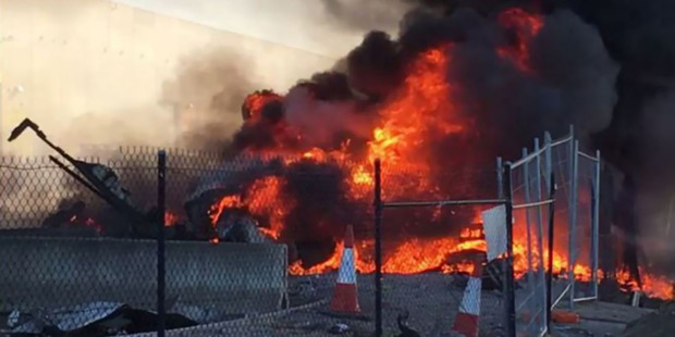 Flames from the scene of the crashed plane at Essendon. Photo / Jordan Fouracre